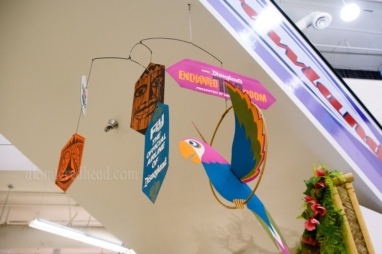 """Cardboard mobile for the Enchanted Tiki Room, multi-color, reading """"Fly the official airline of Disneyland"""""""