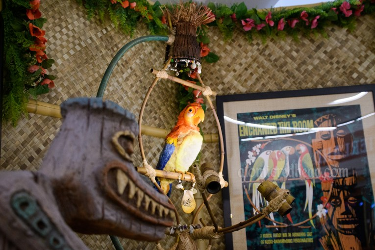 Jose, the parrot from the Enchanted Tiki Room sits on a bamboo perch.