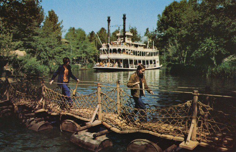 Guests walk across the barrel bridge as the Mark Twain sails past.