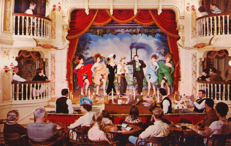 The stage of the Golden Horseshoe with can-can dancers.