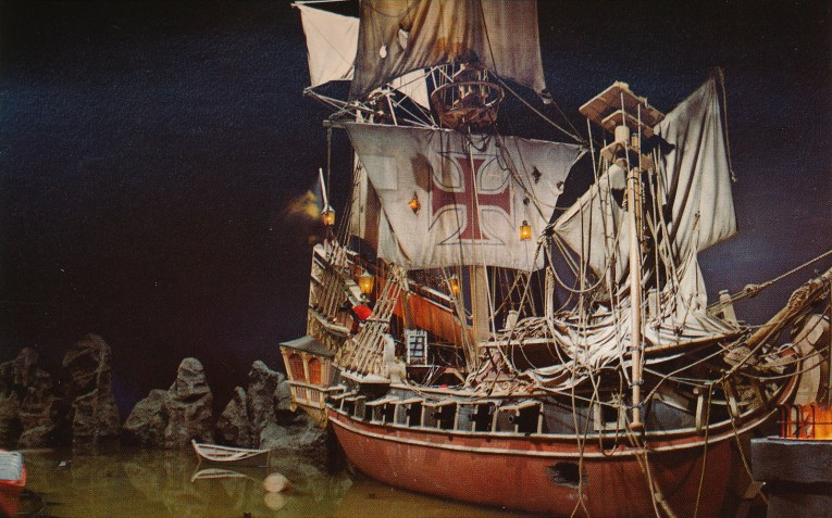 Interior of Pirates - a pirate ship sits in the water, its sails have seen a cannon or two.