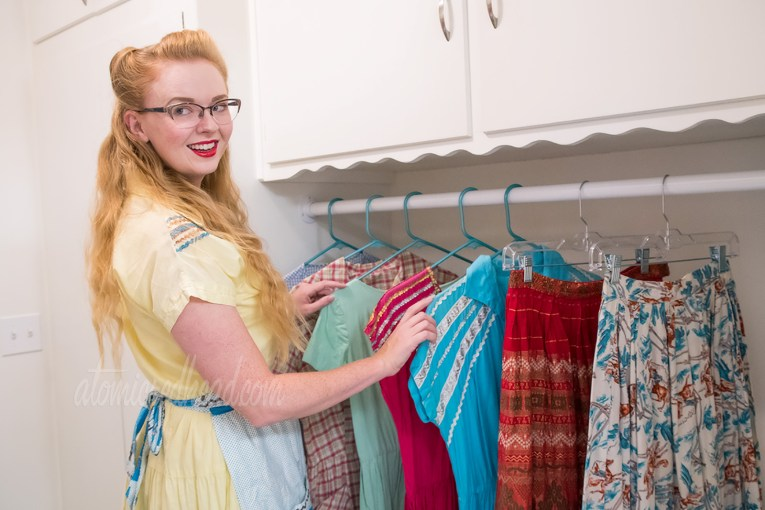 Myself standing in the laundry room checking on clothing I have hung up to dry.