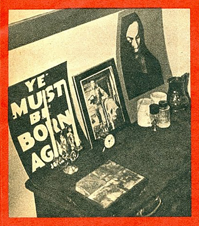 "A photo of Maila's ""altar"" with a photo of James Dean, Vampira, and candles."