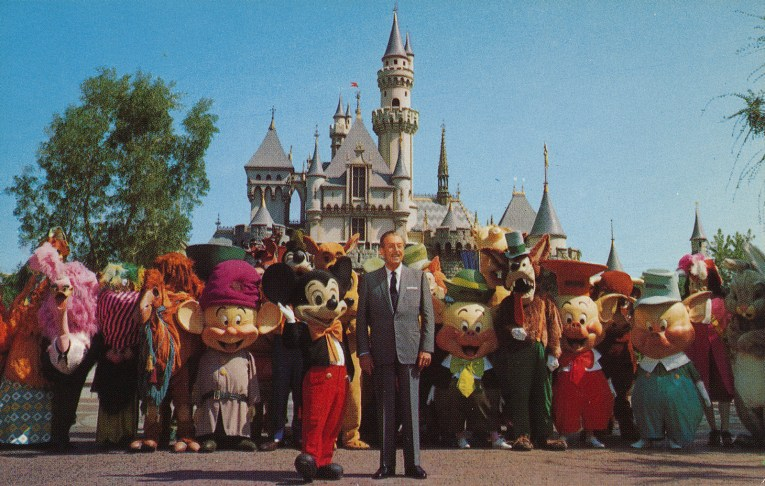 Walt Disney stands with Mickey Mouse, behind them a cavalcade of Disney characters, including the seven dwarves, the three little pigs, and the Big Bad Wolf, all in front of Sleeping Beauty's Castle.
