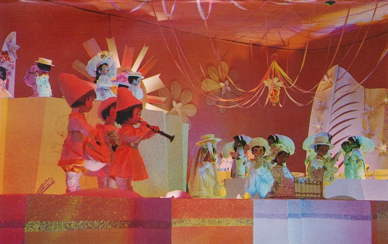 Inside it's a small world: finale scene where every child wears white, but still in traditional garb. Children from northern Europe play musical instruments.