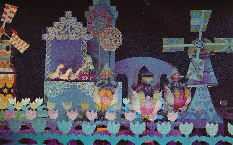 Inside it's a small world: Dutch children sit in giant tulips, a windmill turns in the background.