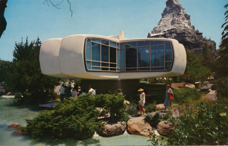 The + shaped House of the Future, with white plastic exterior and floor to ceiling windows.