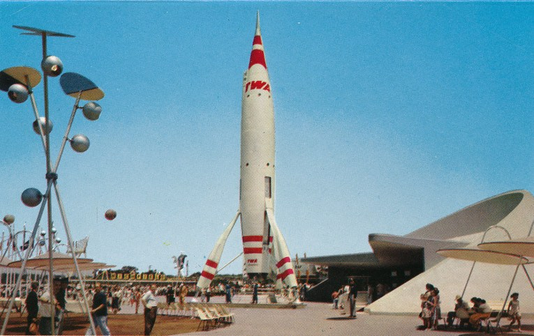 A towering white rocket with red stripes.
