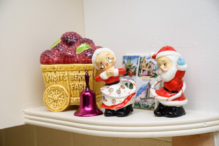 Santa and Mrs. Claus hula-hoop as small vintage salt and pepper shakers.