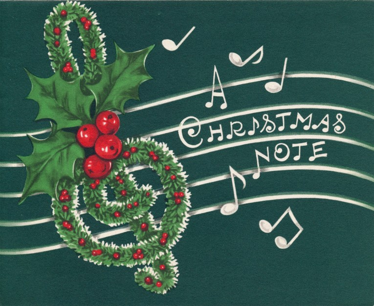 """A green card features a treble clef made of garland, and in a font reminiscent of music notes it reads """"A Christmas Note"""""""