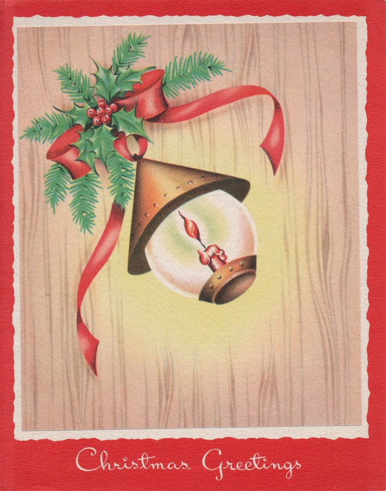 "A lantern hangs against a wooden background. Below it reads ""Christmas Greeting"""
