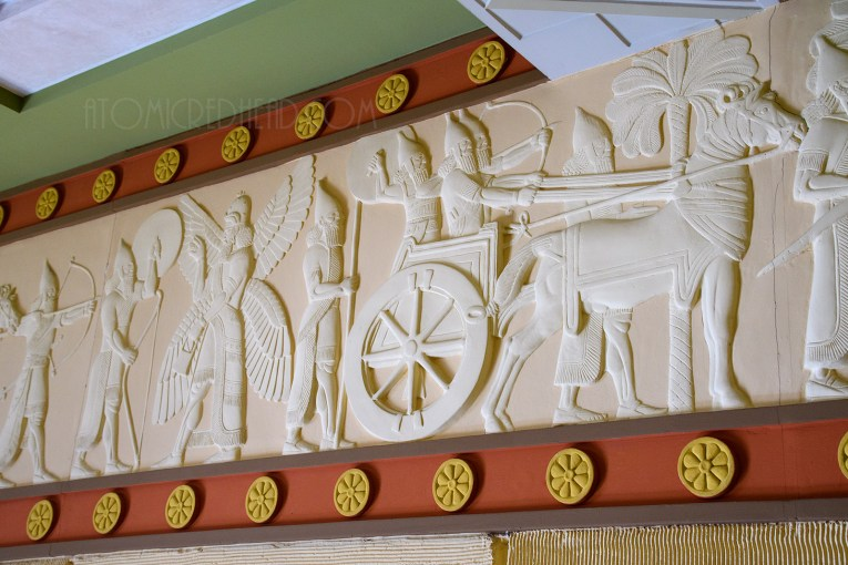 Carvings of chariot races and warriors line the tops of the walls.