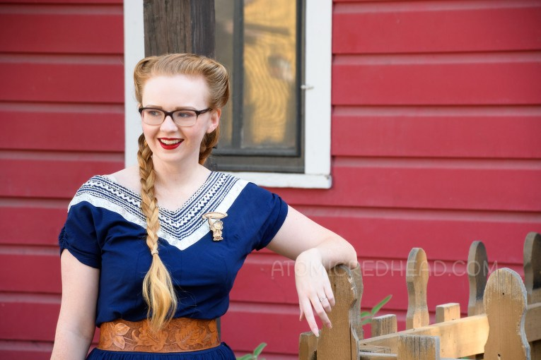 Myself wearing a navy colored patio set with silver ric-rac trim, and a tooled leather belt, purse, and shoes.