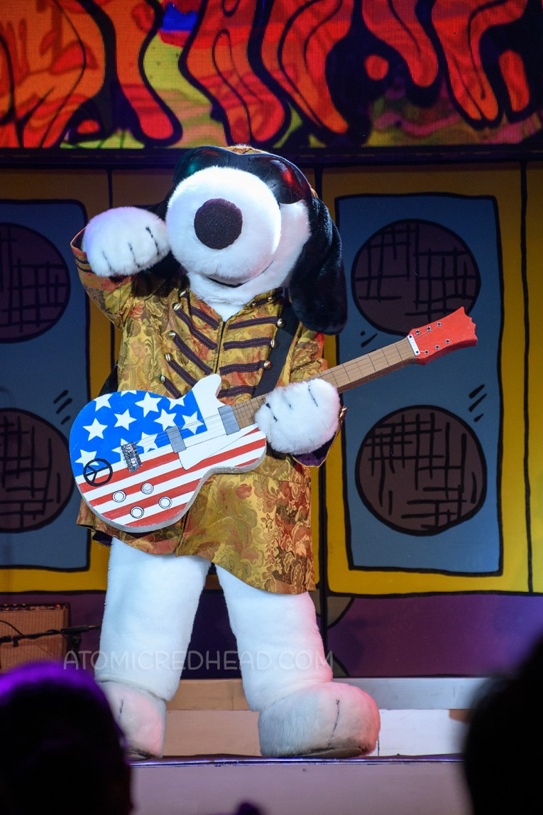 "Snoopy arrives on stage as ""Jimi Hound-rix"" during the Woodstock's Music Festival stage show."