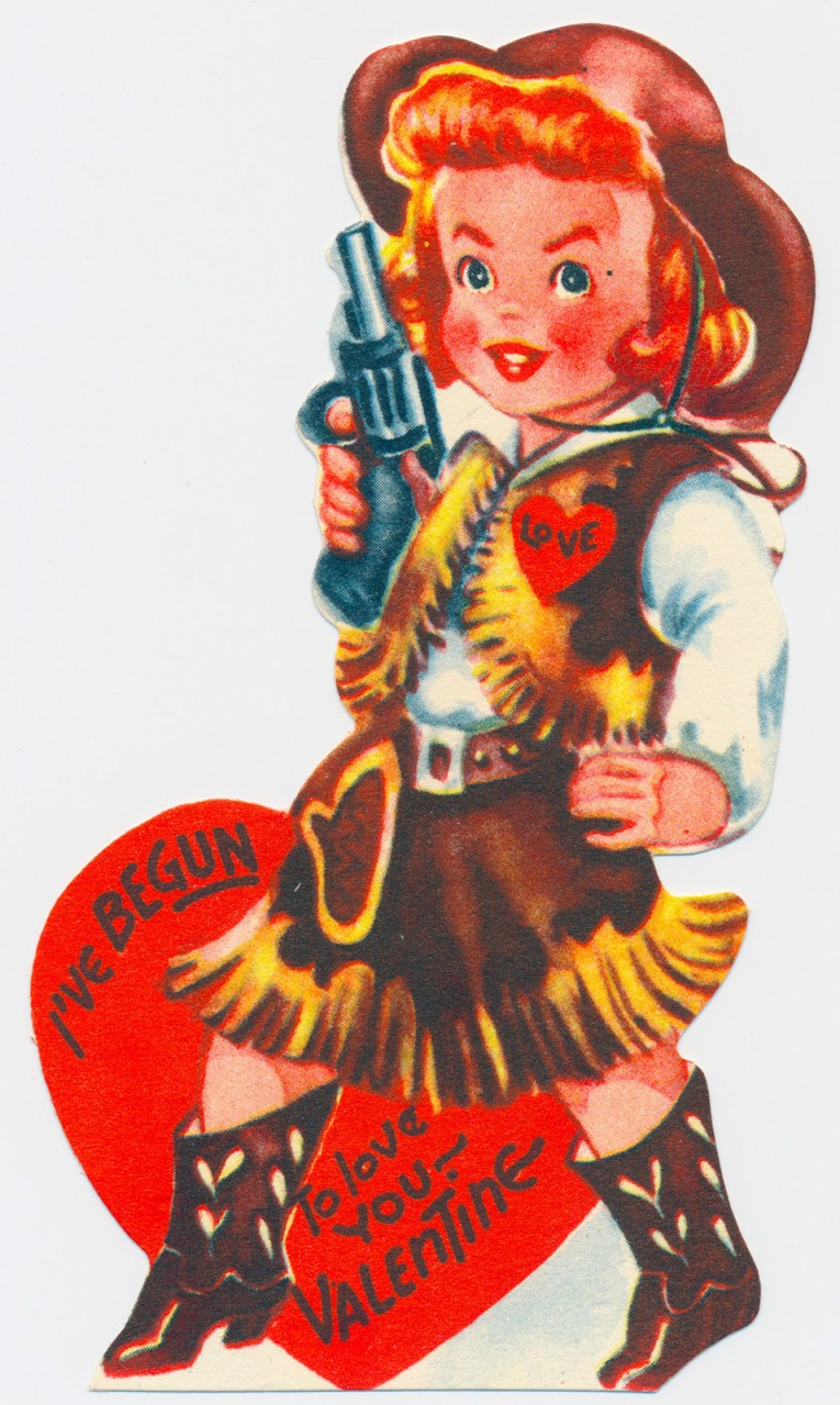 "A cowgirl in a brown fringe ensemble holding a gun. Text reads ""I've begun to love you - Valentine."""