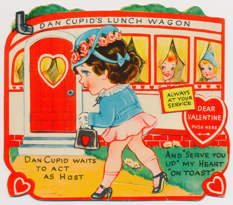 """A girl walks up to a small diner, that reads """"Dan Cupid's Lunch Wagon"""" across the top, a little sign reads """"Always at your service"""" and other text reads """"Dan Cupid waits to act as host and 'serve you up' my heart 'on toast'"""""""