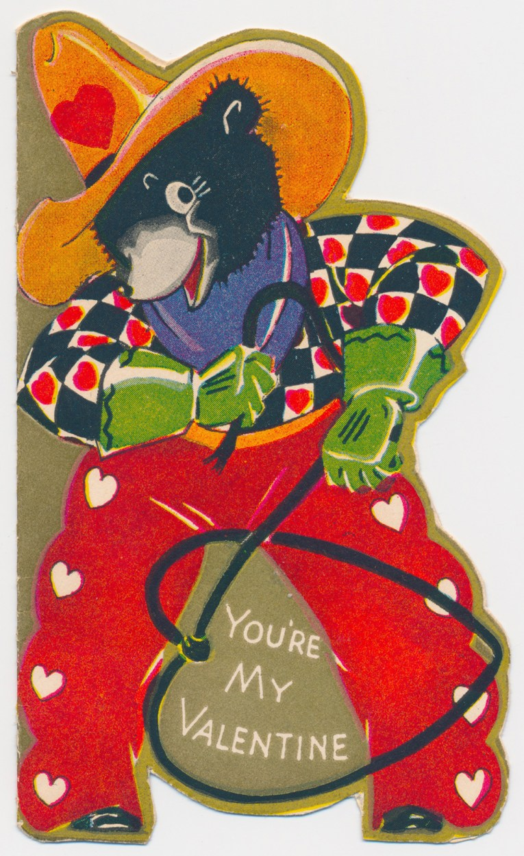 "A bear dressed as a cowboy with a lasso in the shape of a heart. Text reads ""You're my Valentine"""