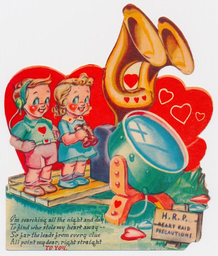 "A boy and a girl stand near a large search light. The boy has headphones on, the girl holds a pair of binoculars. A sign nearby reads ""H.R.P. Heart Raid Precautions"" Other text reads ""I'm searching all the night and day to find who stole my heart away -- So far the leads from every clue all point my dear, right straight o you."""