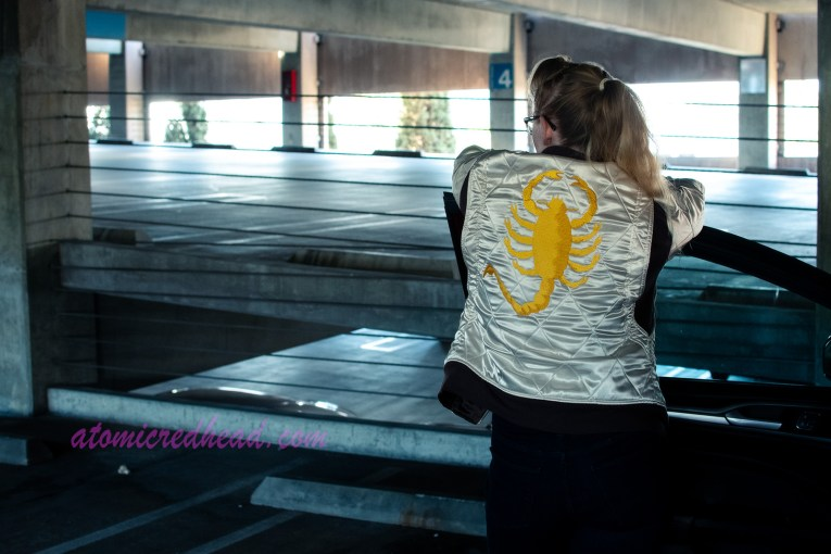 A shot from the back, leaning against the open car door, the back of my jacket visible, which features an a gold embroidered