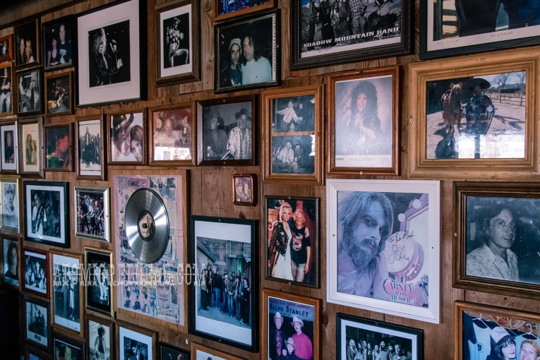 A wall featuring framed photos of all of the various musicians who have played Pappy & Harriet's over the years.