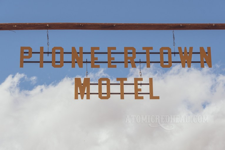 "Large cut out yellow letters spell out ""Pioneertown Motel"""