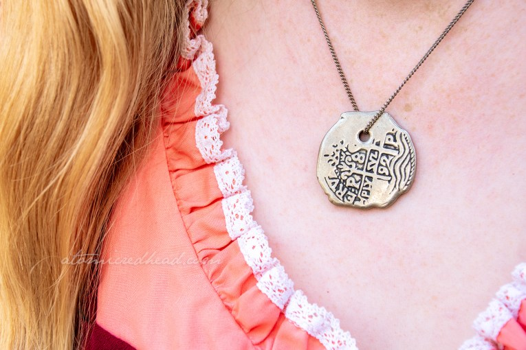 Close-up of my pieces of eight coin necklace.