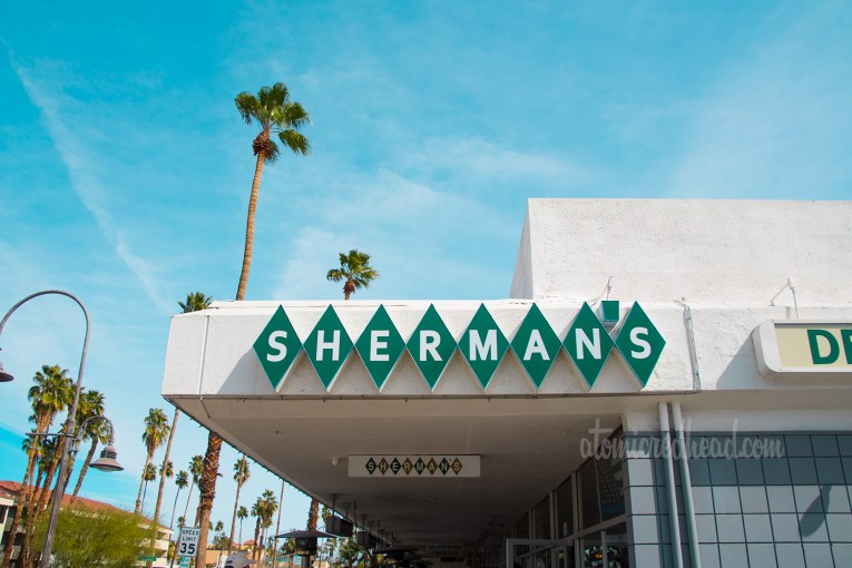 Exterior of Sherman's, featuring Sherman's spelled out in green diamonds.