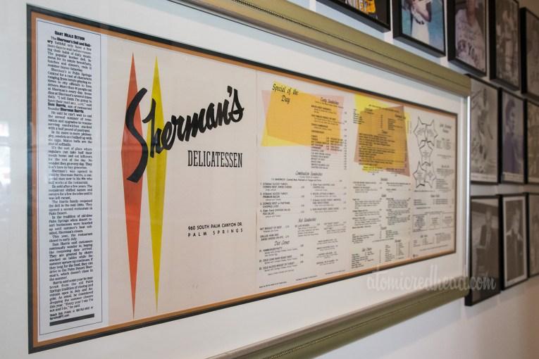 A vintage menu from Sherman's, framed.