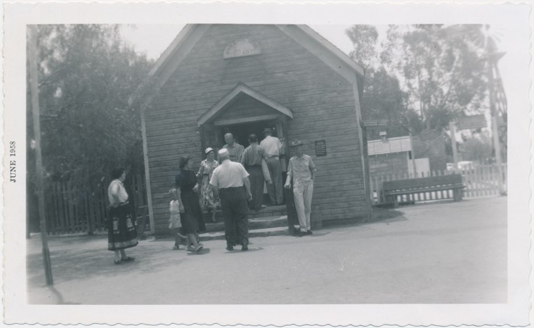 A black and white photo of of the school house.