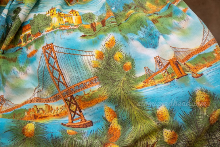 Close-up of the skirt, which features illustrations of the San Fransisco-Oakland Bay Bridge, Mission Santa Barbara and Joshua trees in bloom.