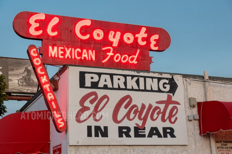 """The red neon sign outside which reads """"El Coyote Mexican Food"""""""