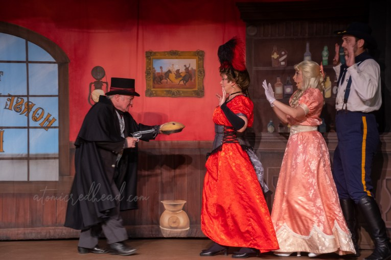 A scene from the melodrama, in which the villain steals a pie from the barmaid, sweet daughter of a baker, and a ranger.