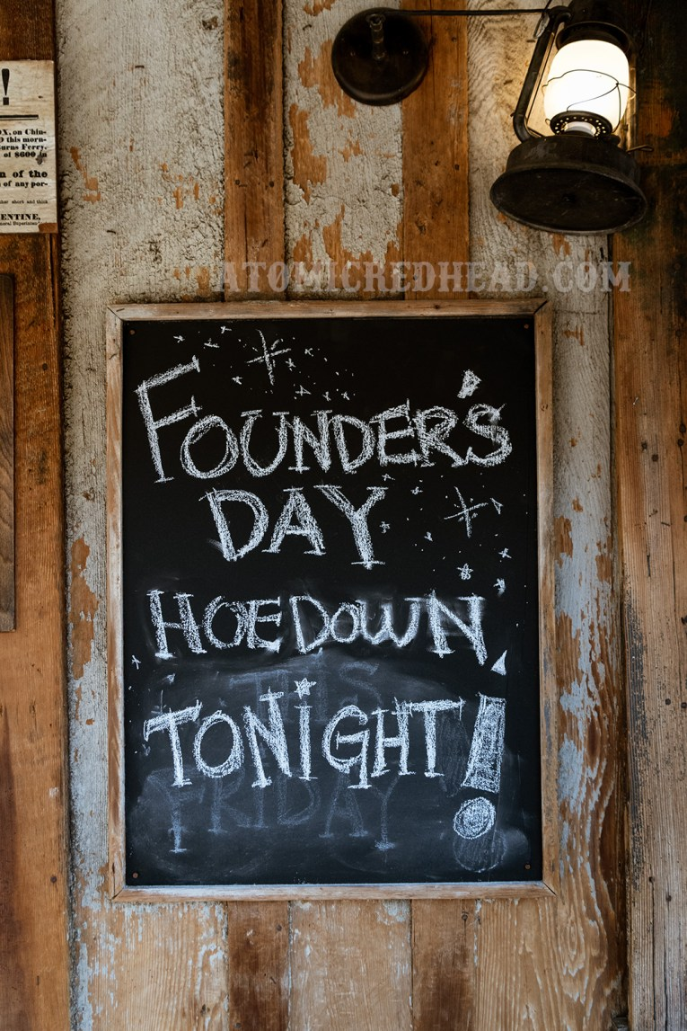 "The chalkboard of the sheriff's office reads ""Founder's Day Hoedown Tonight!"""