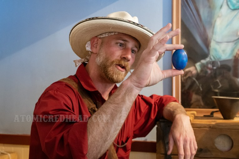 Mr. Colter shows off an egg of one of the rare creatures in town, a bizarre sight, as it is blue with pink spots.