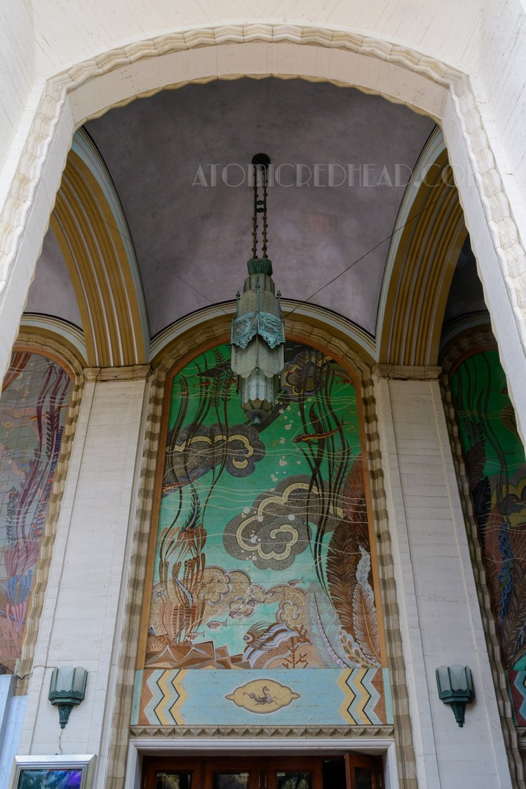 Tall murals grace a covered entry to the Avalon Theatre, each of a different sea scene.