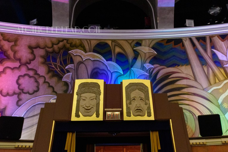 Almost Mayan style masks for comedy and tragedy grace the center doors of the theatre.