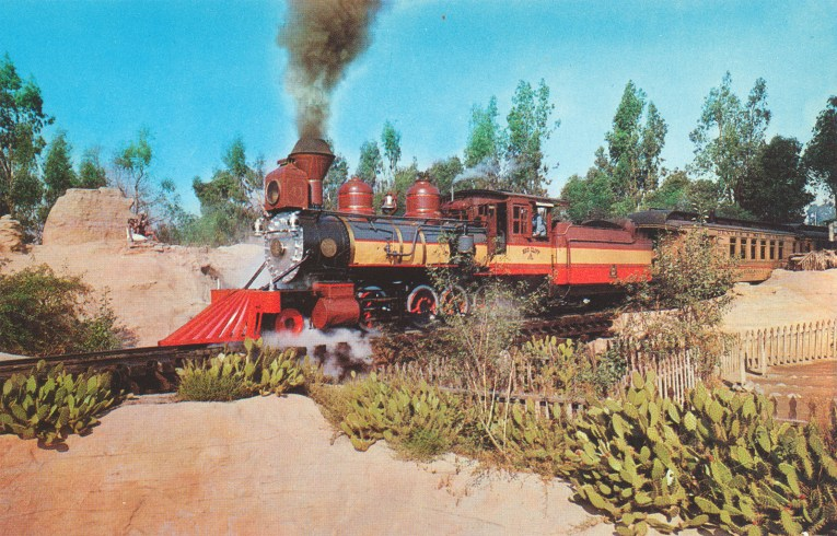 The Ghost Town train chugs past cacti.