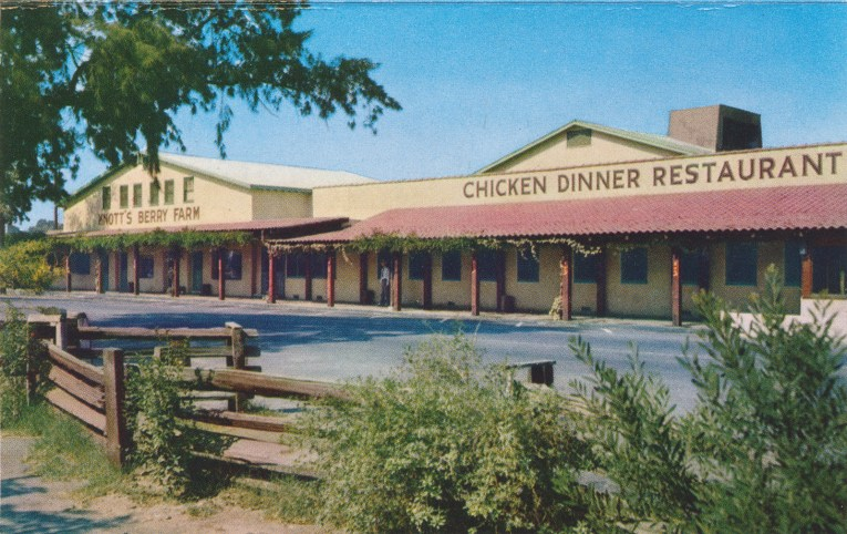 Mrs. Knott's Chicken Dinner Restaurant, a yellow adobe building with red tile roof.