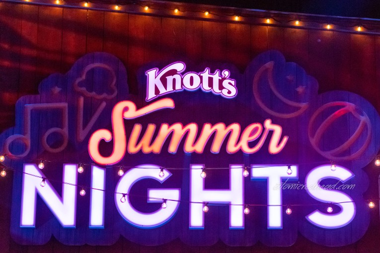 "Close up of the large lighted sign above the stage reading ""Knott's Summer Nights"""