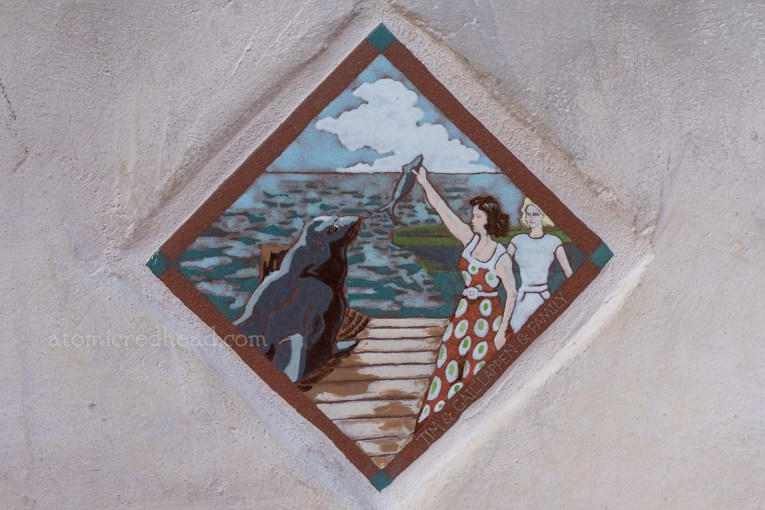 Close up of a tile of two woman feeding Old Ben.