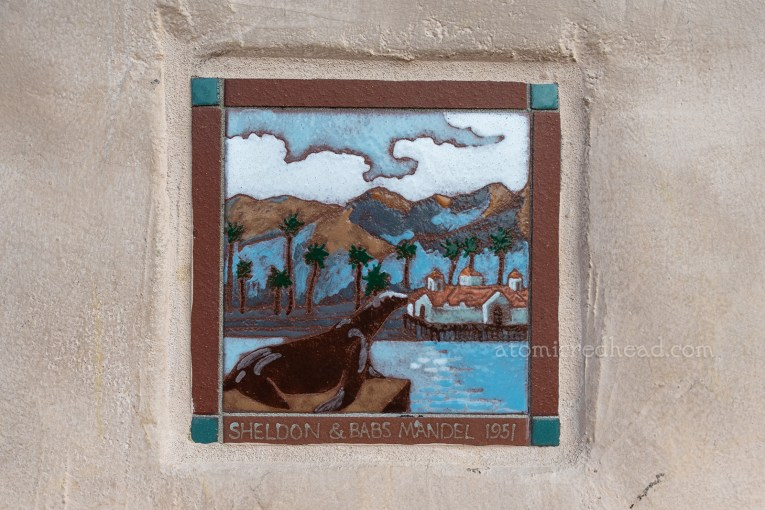 Close up of a tile of Old Ben sitting on a rock.