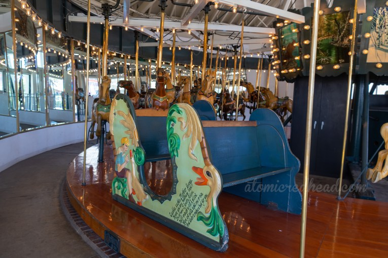 One of the coaches on the carousel, feature a goose head.