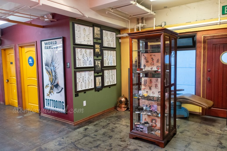 Overview of the museum area of Outer Limits, with framed acetate pieces, photographs, and more.