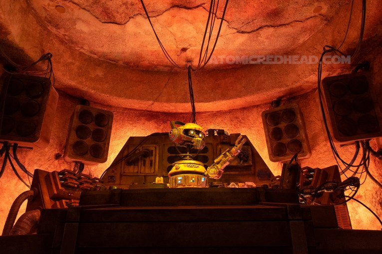 RX-24, nicknamed Rex, formerly the pilot of the Star Tours attraction, now serves as a DJ for the Cantina.