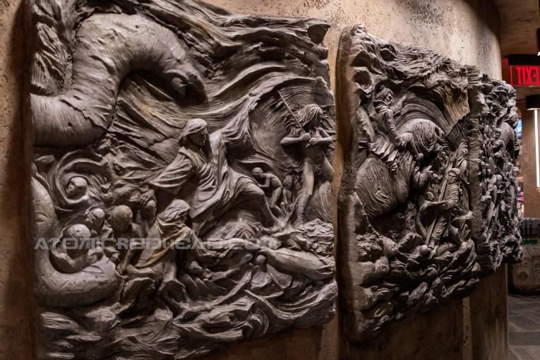 A massive carved scene of Jedi fighting creatures.