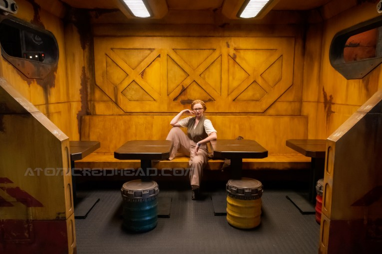 Inside the restaurant Docking Bay 7, a cargo themed restaurant within Galaxy's Edge. Sitting inside a giant cargo crate which acts as a booth.
