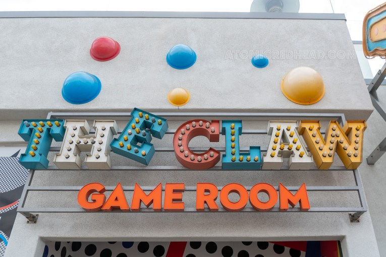 "Multi-colored lighted sign reading ""The Claw Game Room"""