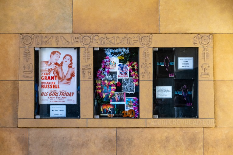 Display cases feature images of upcoming events, which is framed by by raised hieroglyphs.