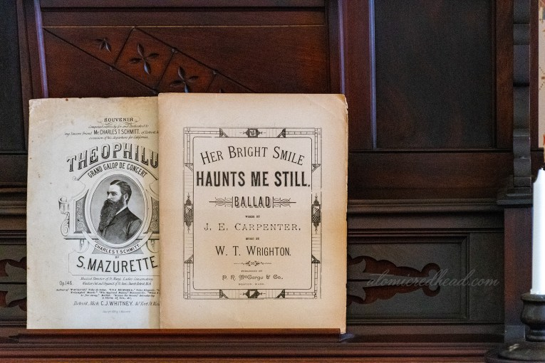 "Sheet music for ""Her Bright Smile Haunts Me Still"" sits upon the organ."