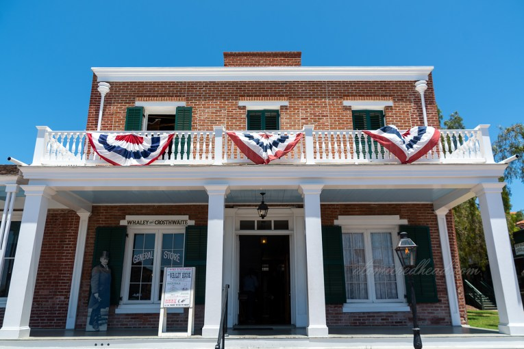 The Whaley House, a small, but stately looking home made of brick featuring a white column porch.